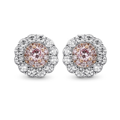 Fancy intense pink and white diamond flower stud earrings mounted in white and rose gold. (0.51Ct TW)